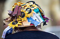 BALTIMORE, MD - MAY 20: A woman wearing a hat adorned with pins and ribbons from previous Preakness Stakes Day walks through the grandstand on Preakness Stakes Day at Pimlico Race Course on May 20, 2017 in Baltimore, Maryland.(Photo by Douglas DeFelice/Eclipse Sportswire/Getty Images)