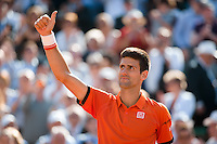 June 3, 2015: Novak Djokovic of Serbia celebrates winning a Quarterfinal match against Rafael Nadal of Spain on day eleven of the 2015 French Open tennis tournament at Roland Garros in Paris, France. Djokovic won 75 63 61. Sydney Low/AsteriskImages