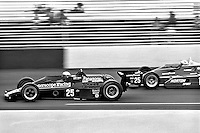 HAMPTON, GA - APRIL 22: Danny Ongais drives his Parnelli VPJ6C/Cosworth TC ahead of Bobby Unser's Penske/Cosworth TC during the Gould Twin Dixie 125 event on April 22, 1979, at Atlanta International Raceway near Hampton, Georgia.
