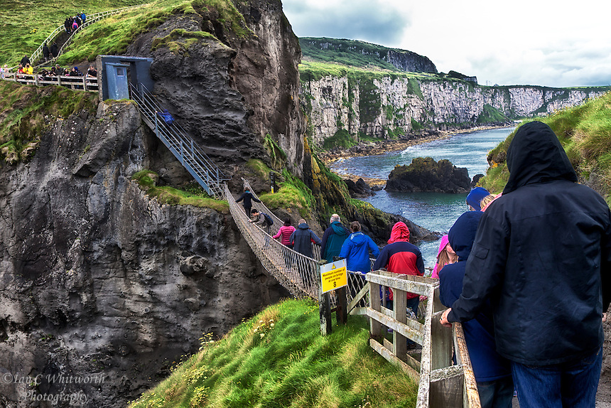 A scenic view of the Carrick-a-Rede Rope Bridge on the Antrim Coast in Northern Ireland.