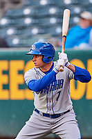 Garin Cecchini (7) of the Omaha Storm Chasers waits to bat against the Salt Lake Bees in Pacific Coast League action at Smith's Ballpark on May 8, 2017 in Salt Lake City, Utah. Salt Lake defeated Omaha 5-3. (Stephen Smith/Four Seam Images)