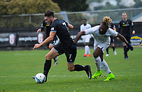 Eric Molloy holds off Andrew Rarangia (right) during the 2019 OFC Champions League quarter final football match between Team Wellington and Henderson Eels at David Farrington Park in Wellington on Sunday, 7 April 2019. Photo: Dave Lintott / lintottphoto.co.nz