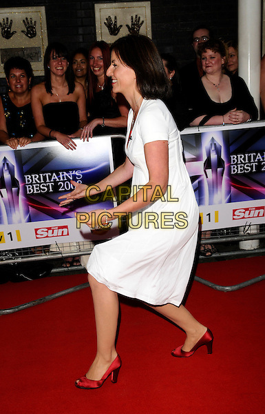 DAVINA McCALL.The Britain's Best 2008 Ceremony, The London Studios, South Bank, London, England..May 18th, 2008.full length white dress red shoes hands profile funny .CAP/CAN.©Can Nguyen/Capital Pictures.