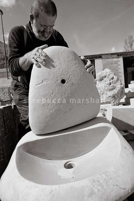 Pierre Gavazzi, stonemason (tailleur de pierre) at work at Annot quarry, Annot, France, 26 April 2010