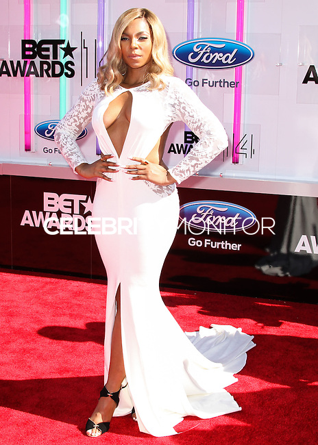 LOS ANGELES, CA, USA - JUNE 29: Singer Ashanti arrives at the 2014 BET Awards held at Nokia Theatre L.A. Live on June 29, 2014 in Los Angeles, California, United States. (Photo by Xavier Collin/Celebrity Monitor)