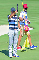 Rickie Fowler (USA) lines up his putt on 5 during round 1 foursomes of the 2017 President's Cup, Liberty National Golf Club, Jersey City, New Jersey, USA. 9/28/2017.<br /> Picture: Golffile   Ken Murray<br /> ll photo usage must carry mandatory copyright credit (&copy; Golffile   Ken Murray)