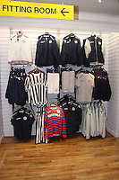 Part of the choice of kit for sale. St Mirren manager Danny Lennon along with Marc McAusland, Jim Goodwin and Sam Parkin celebrating the launch of the new black away kit, featuring a diagonal red stripe across the shirt at JD Sports, Paisley on 12.9.12.
