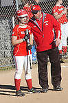 High School coach talks with a player before going to bat.