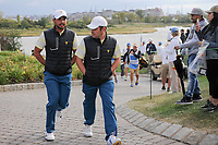 Jason Day (AUS) and Louis Oosthuizen (RSA) make their way to 15 during round 3 Four-Ball of the 2017 President's Cup, Liberty National Golf Club, Jersey City, New Jersey, USA. 9/30/2017.<br /> Picture: Golffile | Ken Murray<br /> <br /> All photo usage must carry mandatory copyright credit (&copy; Golffile | Ken Murray)