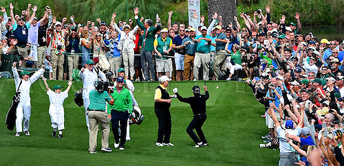 06.04.2016. Augusta, GA, USA. Gary Player, right, and the gallery react to his hole-in-one from the seventh tee box during the Par 3 contest on Wednesday, April 6, 2016, at Augusta National Golf Club in Augusta, Ga