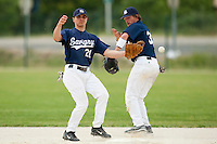 21 May 2009: Yann Dal Zotto of Savigny fails to catch the ball next to Romain Martinez-Scott during the 2009 challenge de France, a tournament with the best French baseball teams - all eight elite league clubs - to determine a spot in the European Cup next year, at Montpellier, France.