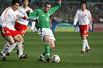 Dublin Ireland, Ireland's No 9 Stephen Elliott holding off China's No 5 Li Weifeng during the friendly international soccer match in Lansdowne Road, Stadium, Dublin, Irelande, 29/3/05.Photo AFP/NEWSFILE/FRAN CAFFREY..(Photo credit should read  AFP Photo FRAN CAFFREY/NEWSFILE)...This Picture has been sent you under the condtions enclosed by:.Newsfile Ltd..the Studio,.Millmount Abbey,.Drogheda,.Co Meath..Ireland..Tel: +353(0)41-9871240.Fax: +353(0)41-9871260.GSM: +353(0)86-2500958.email: pictures@newsfile.ie.www.newsfile.ie.FTP: 193.120.102.198..This picture is from Fran Caffrey@newsfile.ie