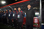 15 JUN 2010:  North Korea head coach Kim Jong Hun (PRK)(right) and his staff.  The Brazil National Team played the North Korea National Team to a 0-0 tie at the end of the 1st half at Ellis Park Stadium in Johannesburg, South Africa in a 2010 FIFA World Cup Group G match.