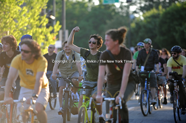 Around 7:00pm, Critical Mass, the popular monthly mass gathering of cyclists, pass the demonstrators led by the organizing committee of Cop Watch and the 1968 Riot Cops Reunion at the Fraternal Order of Police Headquarters in a show solidarity with demonstrators in Chicago, Illinois on June 26, 2009.