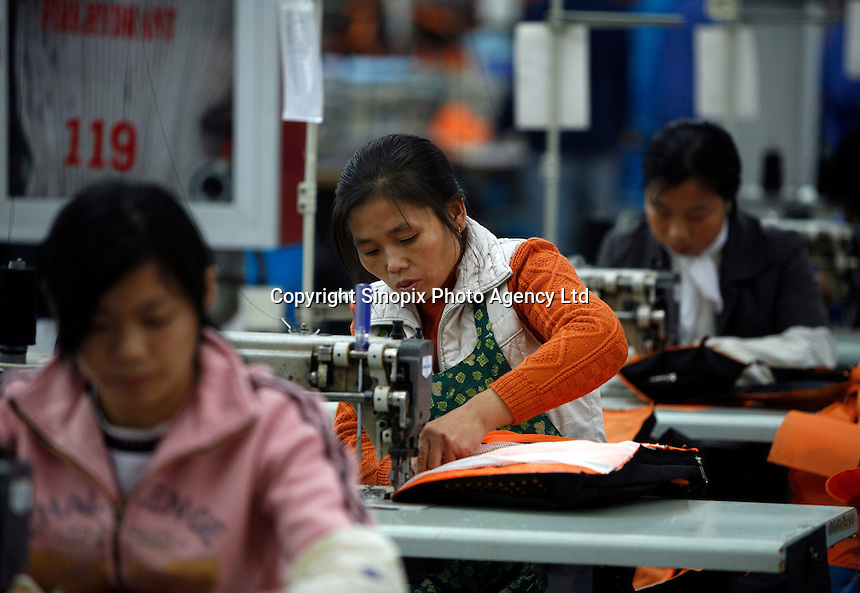 Workers make backpacks at the XinXin Bag Factory in Shanghai, China..