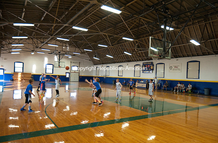 TORRINGTON, CT--- -070115JS09-- Watertown and the Tri-Bury ballers play their Torrington Summer League game TWednesday at the Torrington Armory. The league is celebrating its 30th anniversary this year. <br /> 52 teams of all ages play in the summer league.<br />  Jim Shannon Republican-American