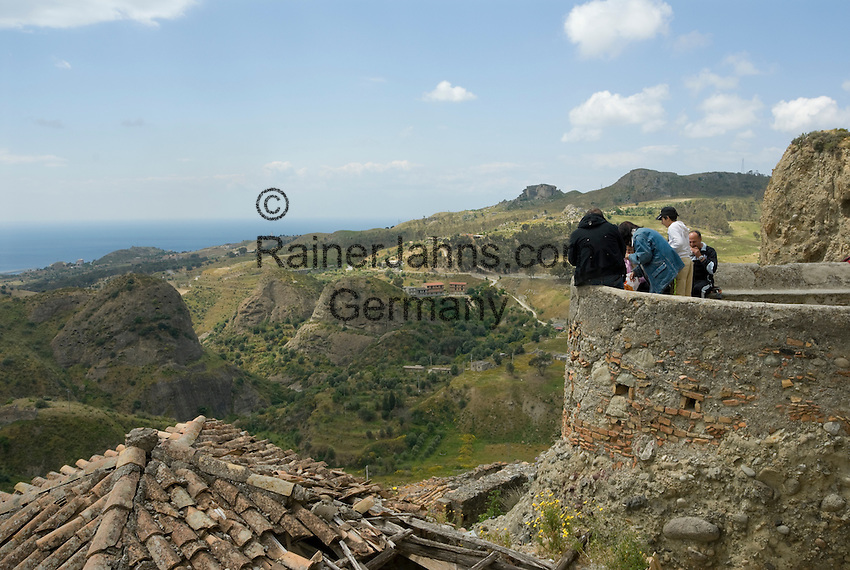 Italy, Calabria, Pentedattilo: one of the most characteristic places of Calabria, secluded mountain village an mountain Monte Calvario, view from village to the sea