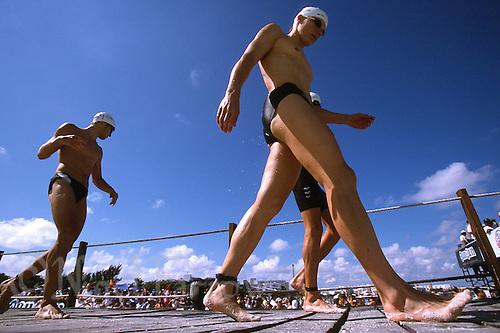 10 NOV 2002 - CANCUN, MEX - Competitors head for the swim start of the Elite Mens ITU World Triathlon Championships (PHOTO (C) NIGEL FARROW)