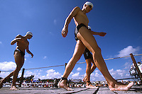 10 NOV 2002 - CANCUN, MEX - Competitors head for the swim start of the Elite Mens ITU World Triathlon Championships (PHOTO (C) NIGEL FARROW)