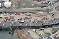 "Early Eastbound Approach Construction, Pearl Harbor Memorial ""Q"" Bridge, just east of Interstate I-95 I-91 CT Route 34 Interchanges. Surface road Water Street at top. Details of approaches, overpasses, ramps & roadway near or within I-95 New Haven Harbor Crossing Corridor projects confines. Photography taken at the beginning of Contract B1 & E1"