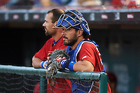 Buffalo Bisons catcher Tony Sanchez (26) and Casey Kotchman (55) in the dugout during a game against the Louisville Bats on June 22, 2016 at Coca-Cola Field in Buffalo, New York.  Buffalo defeated Louisville 8-1.  (Mike Janes/Four Seam Images)