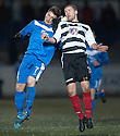Shire's Lloyd Kinnaird and Montrose's Scott Johnston challenge for the high ball.