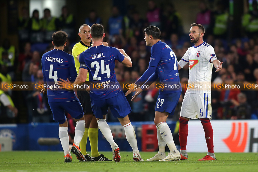 Cesc Fabregas, Gary Cahill and Alvaro Morata run towards Referee Miroslav Zelinka claiming Chelsea's Ruben Loftus-Cheek was fouled in the penalty area during Chelsea vs MOL Vidi, UEFA Europa League Football at Stamford Bridge on 4th October 2018