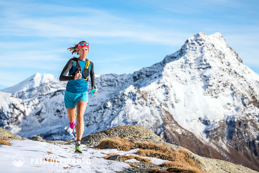 Trail running on the Piz Lunghin above Maloja, Switzerland after an early winter snow storm.