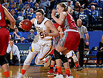 BROOKINGS, SD - FEBRUARY 4:  Ellie Thompson #45 from South Dakota State takes the ball to the basket against Abigail Fogg #44 from the University of South Dakota during their game Saturday afternoon at Frost Arena in Brookings. (Photo by Dave Eggen/Inertia)