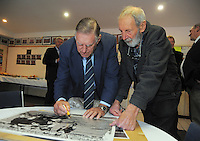 Sir Colin Meads signs a photograph for photographer Peter Bush during the Pink Batts Heartland Championship 2013 season launch at Waikanae RFC, Waikanae, New Zealand on Tuesday, 13 August 2013. Photo: Dave Lintott / lintottphoto.co.nz