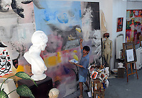 Artsist Christopher Ku works on a massive canvas in his studio in Hong Kong, 19th July 2010. The Wah Luen Industrial Building in Fotan, Hong Kong, home to a community of Hong Kong artsists that have converted the industrial space into studios. <br /> <br /> photo by Richard Jones/Sinopix