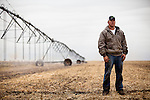 Brett Oelke stands for a portrait next to a center pivot irrigation system on his family's 6,000-acre farm outside of Hoxie, Kan., on Friday, Oct. 12, 2012. As historically dry conditions continue, farmers from South Dakota to the Texas panhandle rely on the Ogallala Aquifer, the largest underground aquifer in the United States, to irrigate crops. After decades of use, the falling water level ? accelerated by historic drought conditions over the last two years ? is putting pressure on farmers to ease usage or risk becoming the last generation to grow crops on the land. Farmers like Mitchell Baalman (not pictured) and Brett Oelke are part of a farming community in in Sheridan County, Kansas, an agricultural hub in western Kansas, who have agreed to cut back on water use for crop irrigation so that their children and future generations can continue to farm and sustain themselves on the High Plains.