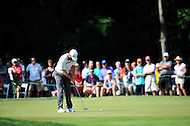 Bethesda, MD - June 29, 2014: Justin Rose sinks a putt on twelve during final round of play at the Quicken Loans National at Congressional Country Club in Bethesda MD. (Photo by Phillip Peters/Media Images International)