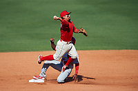 Clearwater Threshers second baseman Drew Stankiewicz (15) turns a double play during the first game of a doubleheader against the Palm Beach Cardinals on April 13, 2017 at Spectrum Field in Clearwater, Florida.  Clearwater defeated Palm Beach 1-0.  (Mike Janes/Four Seam Images)