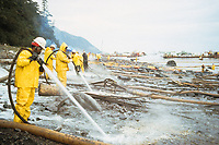 Exxon Valdez Oil Spill Clean up crews use hot water hoses to wash oil from Point Helen, Knight Island, August 1989, Prince William Sound, Alaska