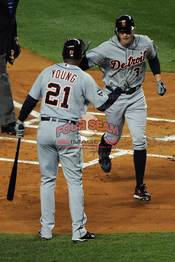 Detroit Tigers outfielder Don Kelly #32 celebrates with Delmon Young #21 after hitting a homerun during ALDS game #5 against the New York Yankees at Yankee Stadium on October 06, 2011 in Bronx, NY.  Detroit defeated New York 3-2 to take the series 3 games to 2 games.  Tomasso DeRosa/Four Seam Images
