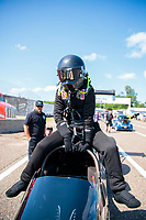 Aug 17, 2019; Brainerd, MN, USA; NHRA top alcohol dragster driver Jasmine Salinas climbs into her car during qualifying for the Lucas Oil Nationals at Brainerd International Raceway. Mandatory Credit: Mark J. Rebilas-USA TODAY Sports