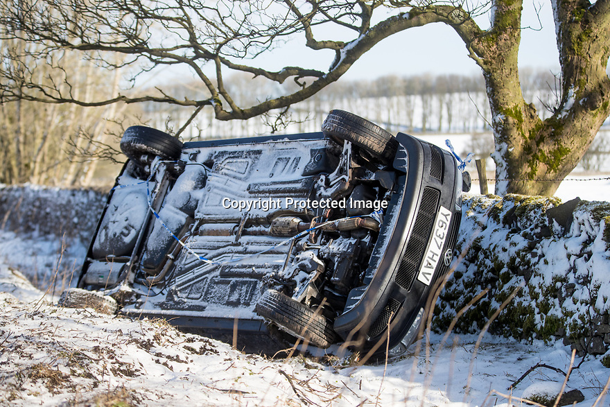 12/02/18<br /> <br /> A car lies in a ditch after skidding off the A515 near Hartington in the Derbyshire Peak District.<br /> <br /> All Rights Reserved F Stop Press Ltd. +44 (0)1335 344240 +44 (0)7765 242650  www.fstoppress.com