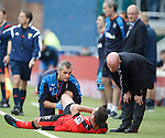 Lee Wallace gets treatment from Stevie Walker and doc Paul Jackson