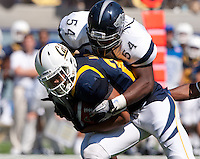 September 1, 2012: California's Keenan Allen is being tackled by Nevada's Jeremiah Green at Memorial Stadium, Berkeley, Ca   Nevada defeated California 31 - 24