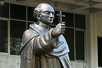 Statue of Bartolome de las Casas, 1484-1566, Spanish friar and historian, at the entrance to the Museo del Hombre Dominicano, founded in 1973 and designed by Jose Antonio Caro Alvarez, on the Plaza de la Cultura in the Colonial Zone, in Santo Domingo, capital of the Dominican Republic, in the Caribbean. The museum houses collections on the culture of the Precolumbian Taino people. Santo Domingo's Colonial Zone is listed as a UNESCO World Heritage Site. Picture by Manuel Cohen