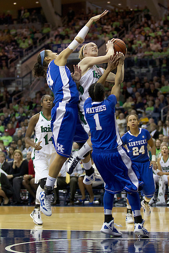Notre Dame guard Natalie Novosel (#21) goes up for a shot as Kentucky center Samantha Drake (#31) and guard A'dia Mathies (#1) defend in second half action during NCAA Women's basketball game between Kentucky and Notre Dame.  The Notre Dame Fighting Irish defeated the Kentucky Wildcats 92-83 in game at Purcell Pavilion at the Joyce Center in South Bend, Indiana.