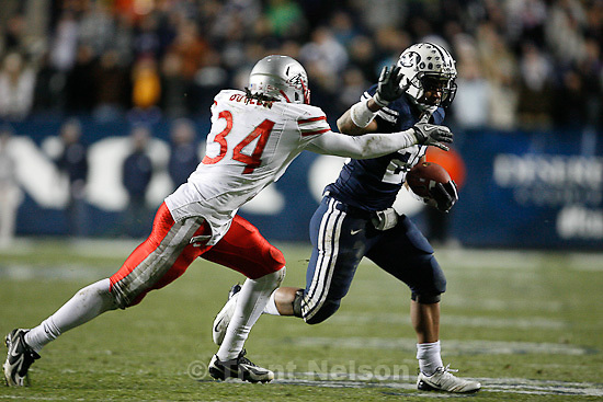 Trent Nelson  |  The Salt Lake Tribune.BYU running back Joshua Quezada (20) runs the ball, with New Mexico's A.J. Butler defending in the second half,  BYU vs. New Mexico, Saturday, November 20, 2010.