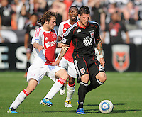 DC United forward Santino Quaranta (25) shields the ball against AFC Ajax defender Daley Blind (17)    AFC Ajax defeated DC United 2-1 during an International Friendly at RFK Stadium Sunday May 22, 2011.