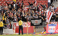 Fans of D.C. United celebrate after they beat of Real Salt Lake at the U.S. Open Cup Final on October  1, 2013 at Rio Tinto Stadium in Sandy, Utah. DC United beat Real Salt Lake 1-0 to win the championship.