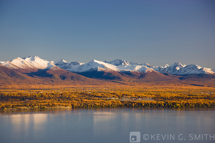 Aerial photo of Knik Arm looking south towards the Chugach Mountains, Joint Base Elmendorf Richardson Radar equipment in the foreground, fall, southcentral Alaska, USA.