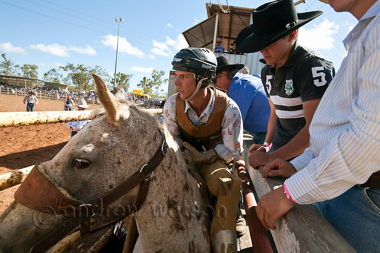 Bareback bronc rider in the bucking chute during the Mt Garnet Rodeo.  Mt Garnet, Queensland, Australia