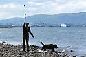Dave (the dog) watchs his owner Amanda Johnston enjoy the sun near Rock Beach, Glen Road, County Down, Northern Ireland, Monday, June 10, 2019.  (Photo by Paul McErlane for Belfast Telegraph)