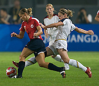 USWMT midfielder (5) Lindsay Tarpley tackles the ball away from Norway's (6) Marie Knutsen during first round play for the 2008 Beijing Olympics in Qinhuangdao, China. .  The US lost to Norway, 2-0, at Qinhuangdao Stadium.