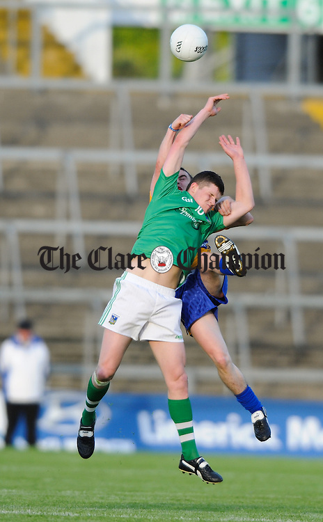 Martin Mc Mahon of Clare in action against Ian Corbett of Limerick during their  Senior championship semi-final at the Gaelic Grounds. Photograph by John Kelly.